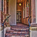 External corridor leading to wooden door, Ca' d'Zan Mansion